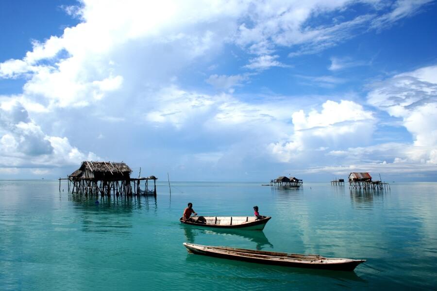 Maleisie West en Oost Maleisie tropisch vis dorp met boot mensen