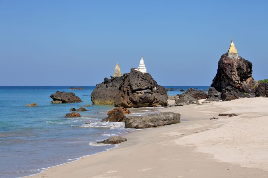 Myanmar Ngwe Saung beach Buddhist pagodas on top of rocks