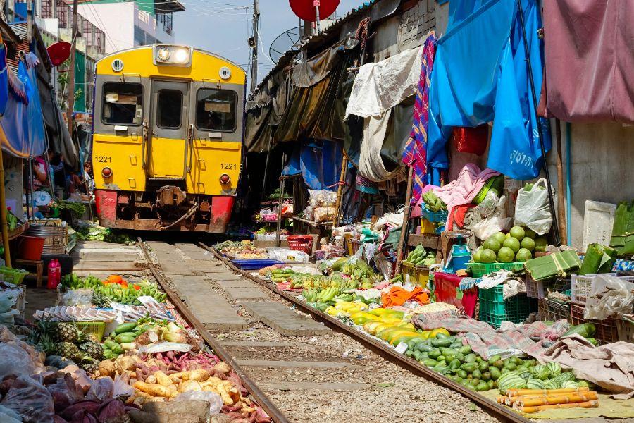 Thailand Bangkok Maeklong railroad tracks market Train Market
