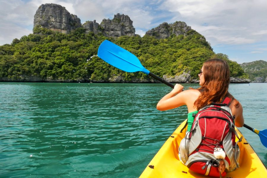Thailand Koh Samui Ang Thong National Marine Park Young woman kayaking