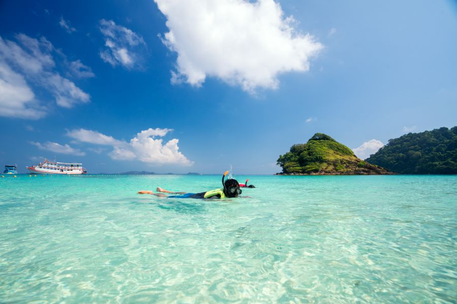 Thailand Kam Beach strand near Koh Kood and Koh Mak boy is swimming and snorkling in the sea