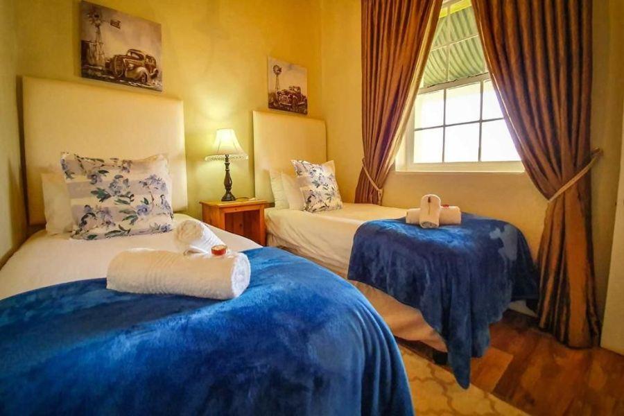 Berluda Farmhouse Cottages Oudtshoorn Zuid Afrika slaap kamer