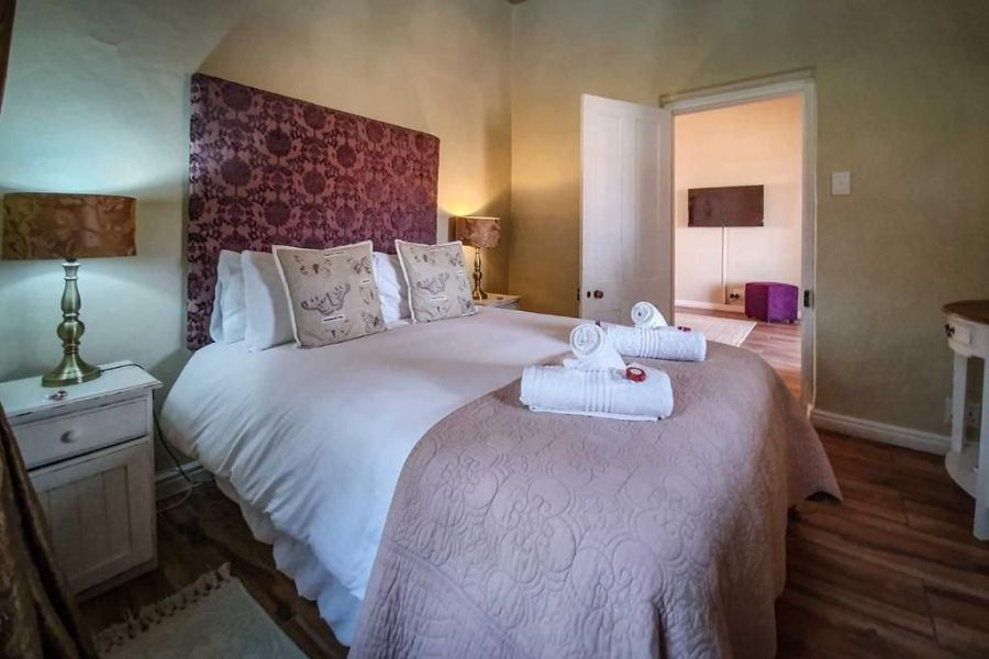 Berluda Farmhouse Cottages Oudtshoorn Zuid Afrika slaapkamer